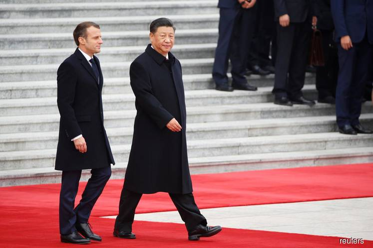 China and France sign deals worth US$15b during Macron's visit