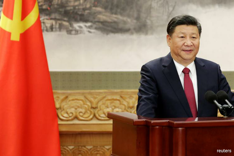 """""""Things are on track for President Xi Jinping's visit to Japan, and we are proceeding as usual with preparations,"""" Chief Cabinet Secretary Yoshihide Suga told a news conference. (Photo by Reuters)"""