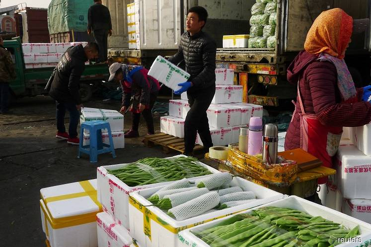 "Beijing district in ""wartime emergency"" after virus cluster at major food market"