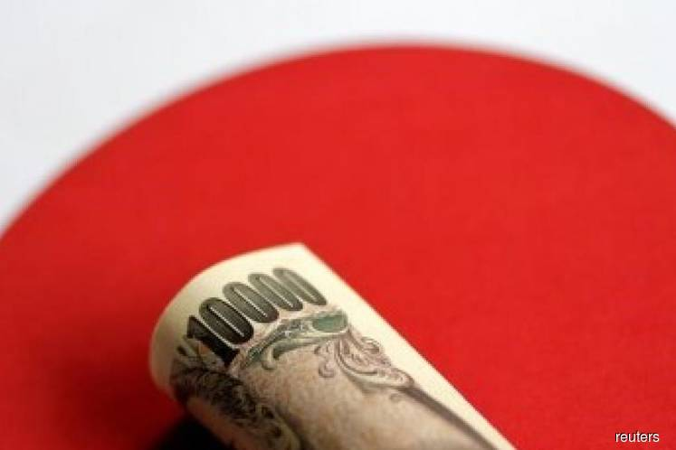 Japan launches US$122 bil stimulus to fight trade risks, post-Olympic slump