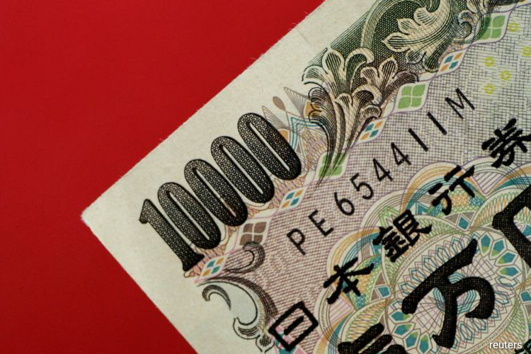 Though it barely budged on Friday, the yen has lost 2% against the dollar in the previous two days. (Photo by Reuters)