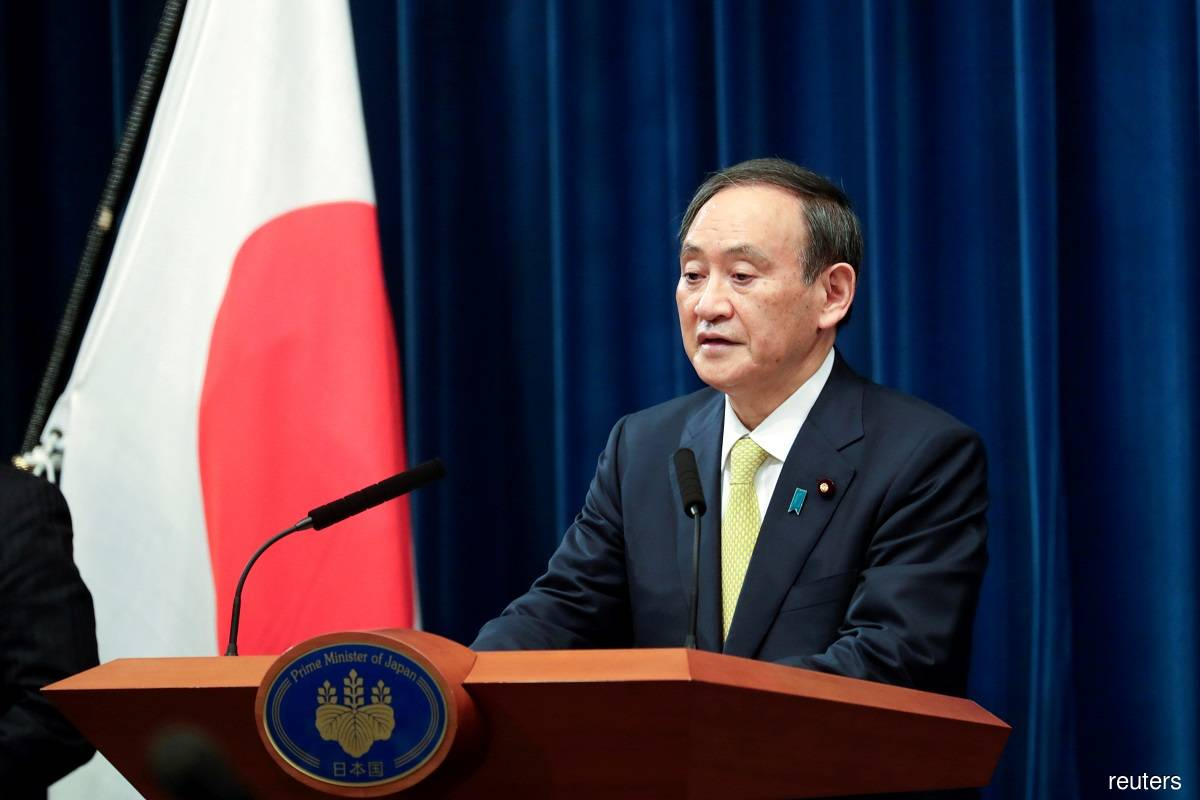 Japanese PM Suga apologises after lawmakers' nightclub outings