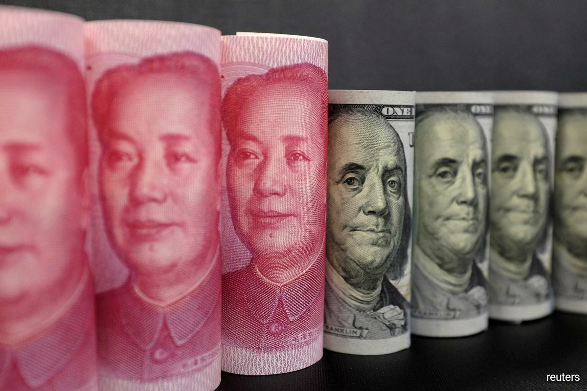 The yuan surged in both offshore and onshore trading. The offshore yuan hit a 16-month high of 6.7725 versus the U.S. dollar before easing slightly CNH=EBS. (Photo by Reuters)