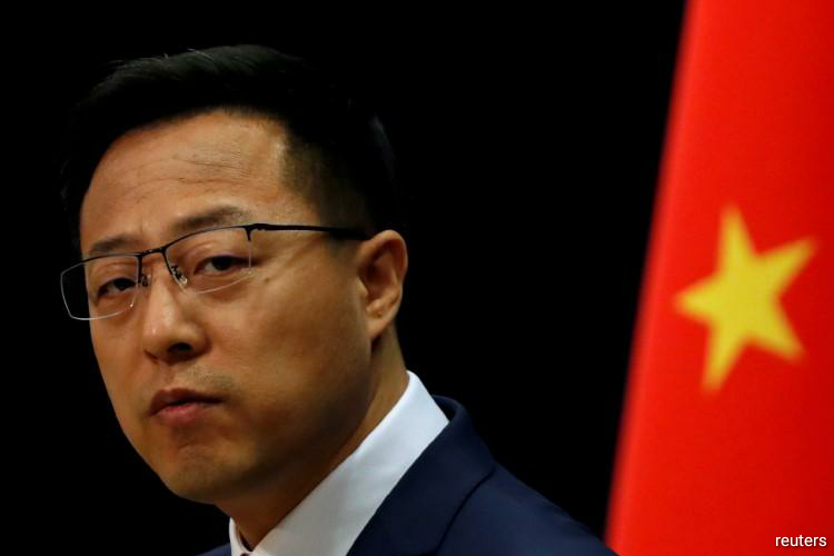 Ministry spokesman Zhao Lijian named the Associated Press, National Public Radio, CBS and United Press International news agency as companies asked to submit the requested information in writing within seven days. (Photo by Reuters)